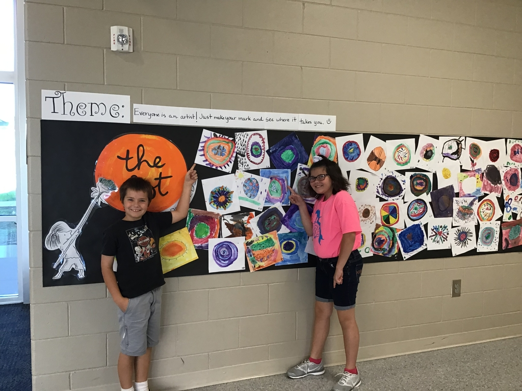 Students showing off their artwork.